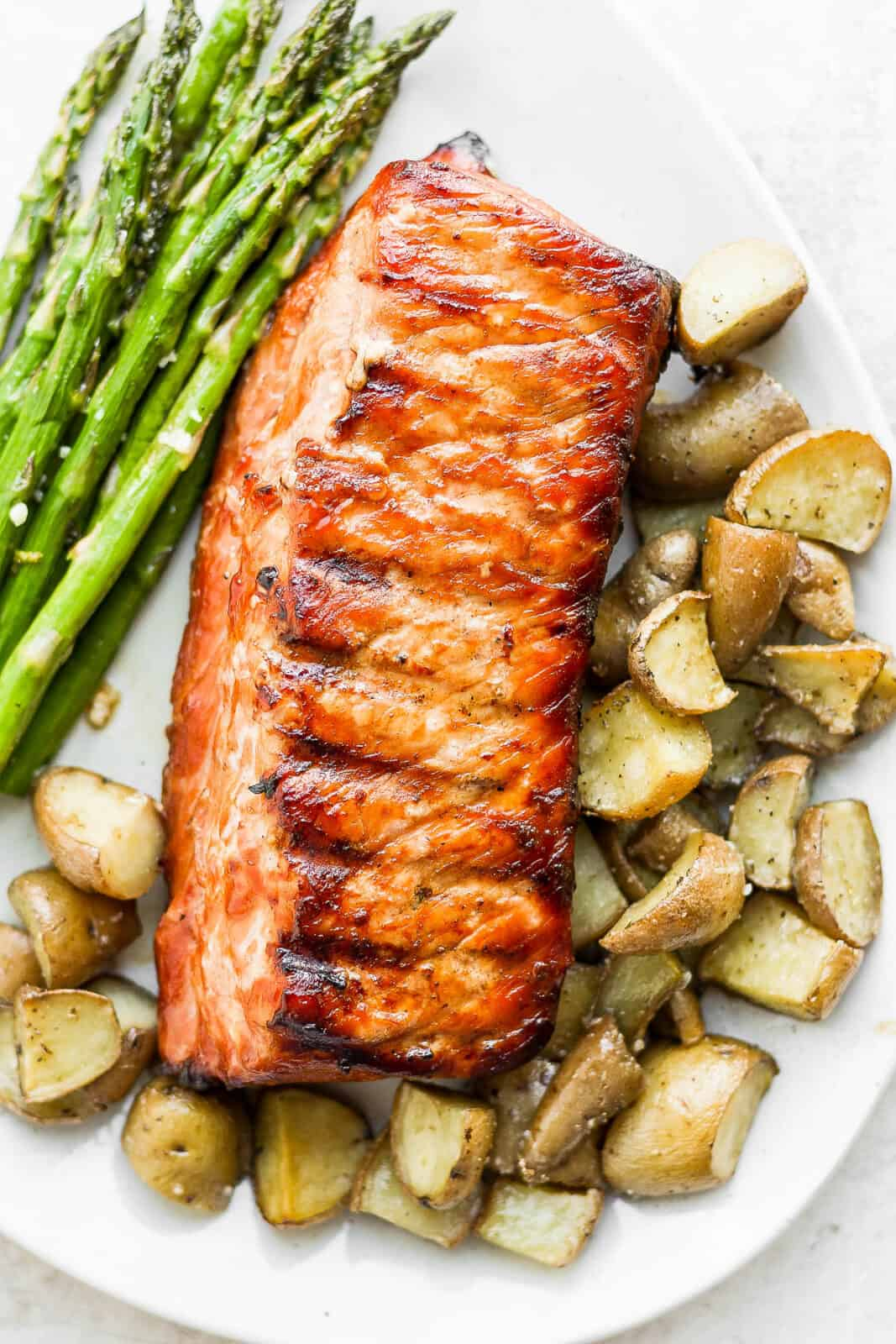 A platter with smoked potatoes, smoked asparagus and pork loin.