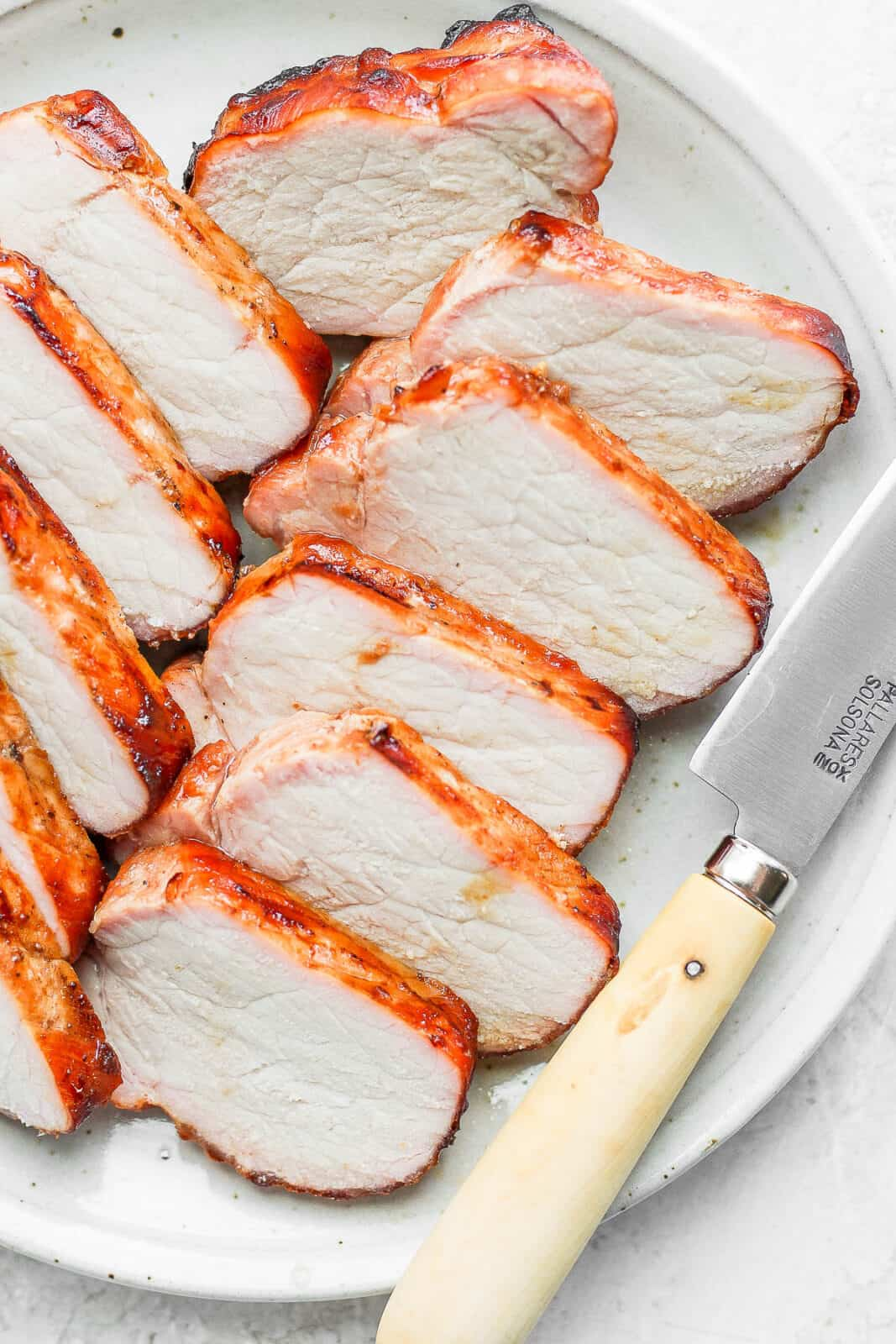 Sliced of smoked pork loin on a plate.
