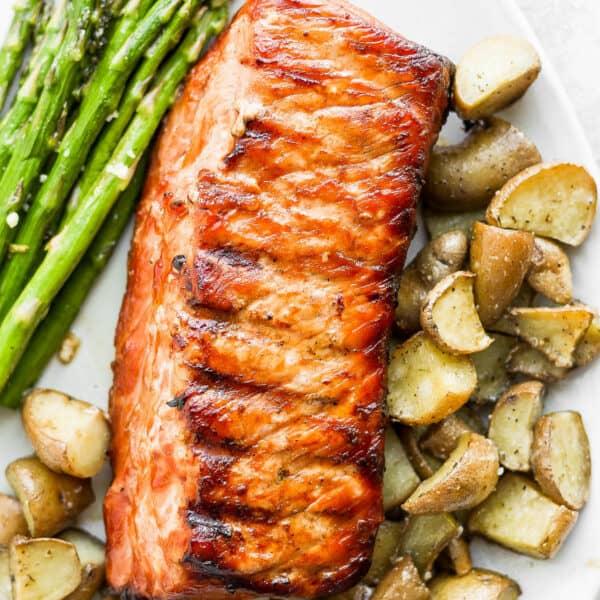 Plate of smoked pork loin, smoked potatoes and smoked asparagus.