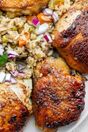 A plate of baked chicken and rice.
