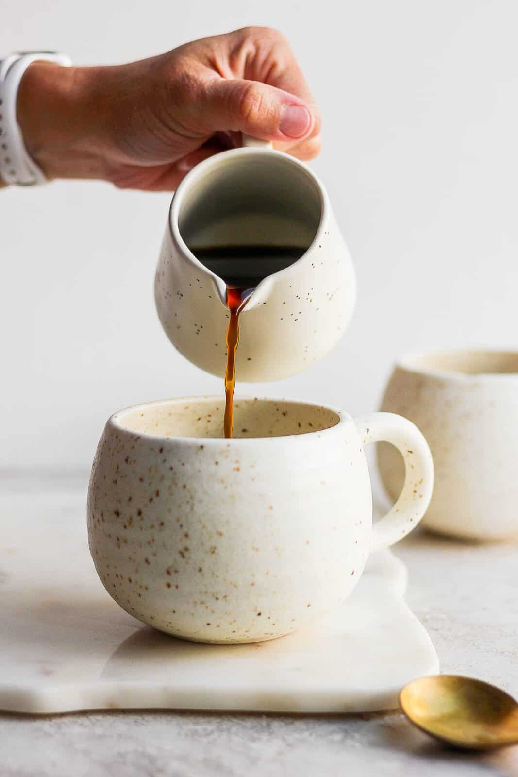 Coffee being poured into a mug.