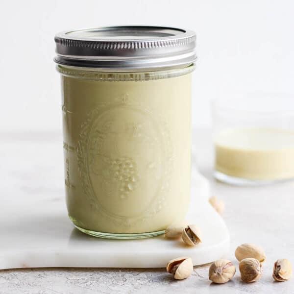 Mason jar full of pistachio milk.