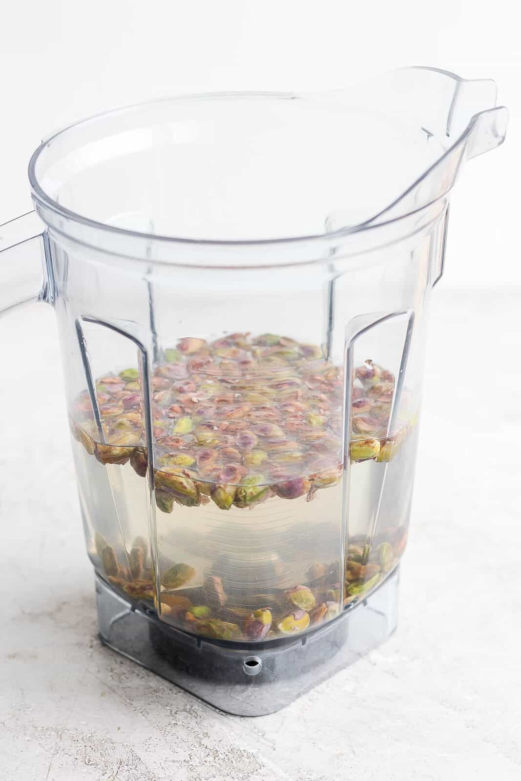 Pistachios in a blender with water.